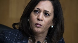 "Senator Kamala Harris, a Democrat from California, listens during a Senate Homeland Security and Governmental Affairs Committee hearing in Washington, D.C., U.S., on Thursday, June 25, 2020. Acting commissioner of U.S. Customs and Border Protection, Mark Morgan, said this week said at a roundtable event with President Donald Trump that he's ""100% convinced"" that 450 miles of the border wall with Mexico will be completed by the end of the year. Photographer: Tom Williams/CQ Roll Call/Bloomberg via Getty Images"