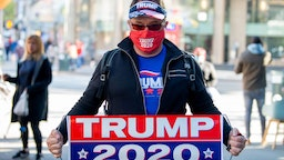 A man wearing a 'Trump 2020' mask and gear poses amid the coronavirus pandemic on May 5, 2020 in New York City. COVID-19 has spread to most countries around the world, claiming over 257,000 lives with over 3.7 million cases.