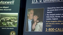 A photograph of Ghislaine Maxwell and Jeffrey Epstein is displayed during a news conference at the U.S. Attorney's Office in New York, U.S., on Thursday, July 2, 2020.