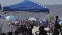 People gather at Mission Beach in San Diego, California.