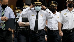 Chicago police Superintendent David Brown, center, walks outside Advocate Illinois Masonic Medical Center to provide information about the police shooting on Thursday, July 30, 2020.