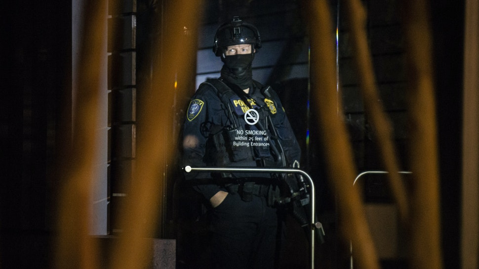 PORTLAND, OR - AUGUST 2: A federal officer guards the interior of the Edith Green - Wendell Wyatt Federal Building early in the morning on August 2, 2020 in Portland, Oregon. Federal officers began a phased withdrawal from the city on Thursday while leaving behind personnel inside the two downtown federal buildings. (Photo by Nathan Howard/Getty Images)