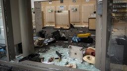 Broken glass and destroyed merchandise displays lay on the ground at a Nordstrom Inc. Rack store following looting on Michigan Avenue in Chicago, Illinois, U.S., on Monday, Aug. 10.