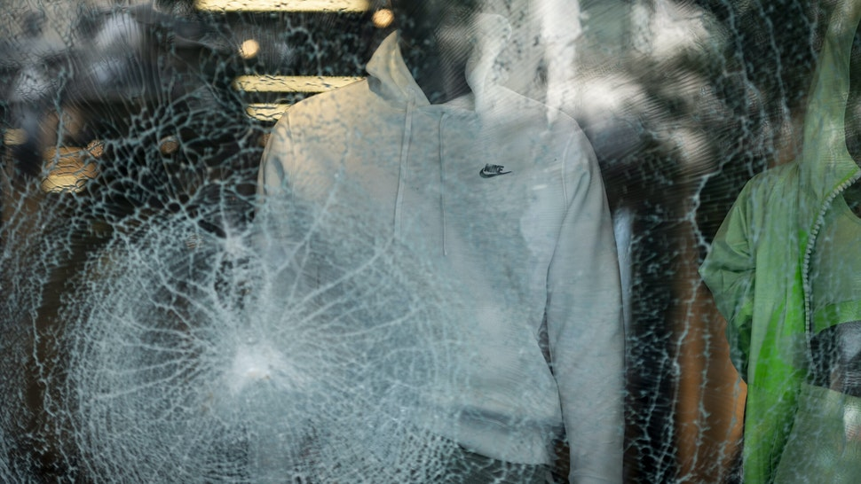 The glass window display of a Nike Inc. store stands shattered following looting on Michigan Avenue in Chicago, Illinois, U.S., on Monday, Aug. 10, 2020. Chicago police arrested more than 100 people for looting, disorderly conduct and battery against officers, among other charges, as crowds of people descended upon the city's downtown overnight, Superintendent David Brown said during a press conference Monday. Photographer: Christopher Dilts/Bloomberg via Getty Images