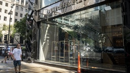 A pedestrian looks at the broken window of a Burberry store following looting on Michigan Avenue in Chicago, Illinois, U.S., on Monday, Aug. 10, 2020. Chicago police arrested more than 100 people for looting, disorderly conduct and battery against officers, among other charges, as crowds of people descended upon the city's downtown overnight, Superintendent David Brown said during a press conference Monday. Photographer: Christopher Dilts/Bloomberg via Getty