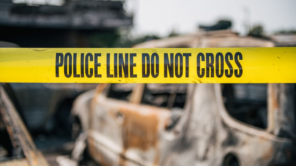 KENOSHA, WI - AUGUST 24: Caution tape at a burned down used car lot on August 24, 2020 in Kenosha, Wisconsin. A night of civil unrest occurred after the shooting of Jacob Blake, 29, on August 23. Blake was shot multiple times in the back by Wisconsin police officers after attempting to enter into the drivers side of a vehicle. (Photo by Brandon Bell/Getty Images)