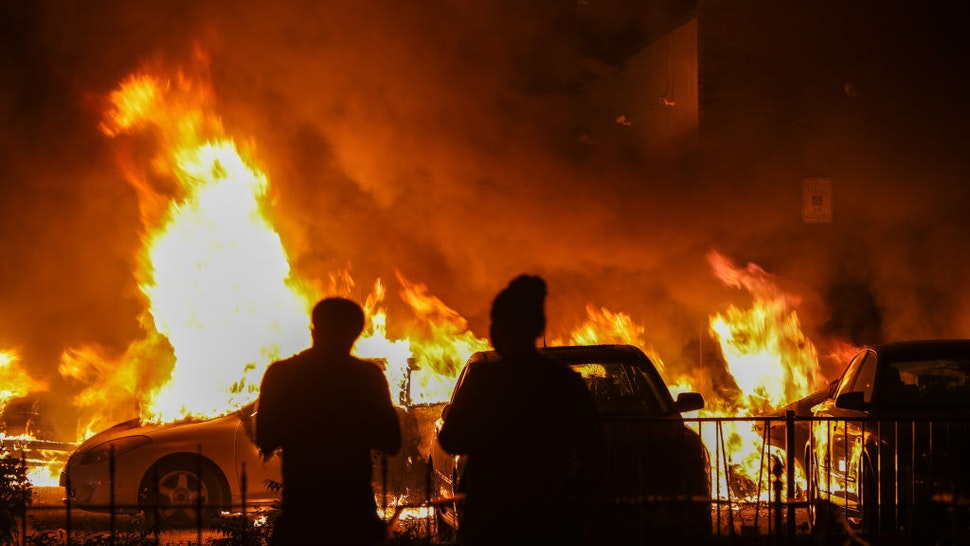 Jacob Blake protesters lit vehicles on fire in Kenosha, Wisconsin, United States on August 24, 2020.