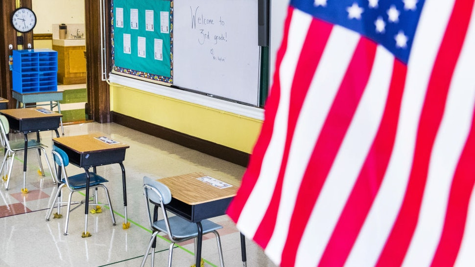 An American flag is displayed in a classroom at a Catholic elementary school in Brookline, Massachusetts, U.S., on Tuesday, Aug. 25, 2020. Schools in just 15 districts will fully reopen for instruction this fall as the majority of Massachusetts school districts plan to welcome students back to school part-time or not at all, according to state data. Photographer: Adam Glanzman/Bloomberg via Getty Images
