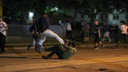 Clashes between protesters and armed civilians, who protect the streets of Kenosha against the arson, break out during the third day of protests over the shooting of a black man Jacob Blake by police officer in Wisconsin, United States on August 25, 2020.