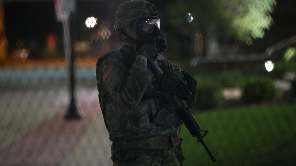 KENOSHA, WISCONSIN, USA - AUGUST 25: Police take security measurements during a third night of unrest on August 25, 2020 in Kenosha, Wisconsin, United States. Wisconsin expands Natâl Guard presence amid unrest. Governor declares state of emergency as civil unrest in Kenosha continues after Black man was shot several times at close range in the back during an encounter with a police officer on Sunday. (Photo by Tayfun Coskun/Anadolu Agency via Getty Images)