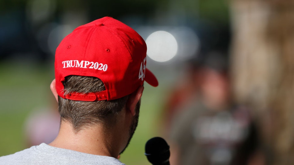 CHARLOTTE, NC - AUGUST 27: A President Donald Trump supporter speaks talks on the microphone during the RNC 2020 Trump Biker Rally & Back the Blue Parade held at Park Road Park on August 27, 2020 in Charlotte, North Carolina. The bike rally for Trump will watch the Republican National Convention at a local sports bar to see President Donald Trump gives his acceptance speech. (Photo by Octavio Jones/Getty Images)