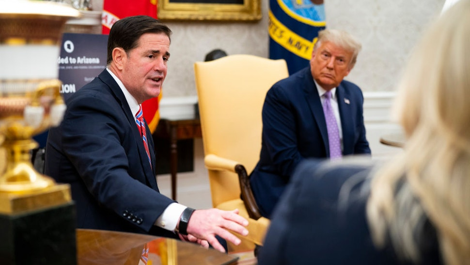 U.S. President Donald Trump meets with Arizona Governor Doug Ducey (L) in the Oval Office of the White House on August 5, 2020 in Washington, DC.