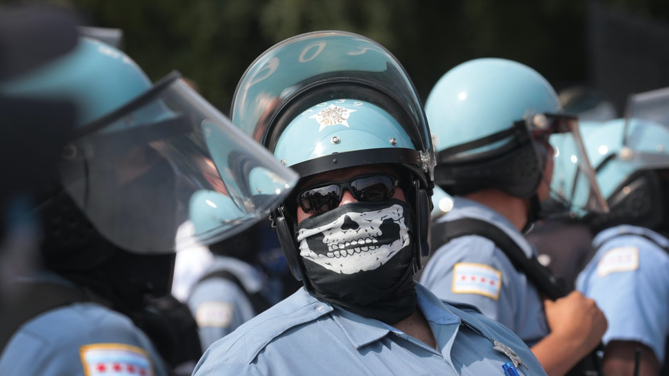 CHICAGO, ILLINOIS - AUGUST 15: Police stand guard as pro and anti-police demonstrators gather outside of the Homan Square police station on August 15, 2020 in Chicago, Illinois. The demonstration was one of several in the city today, either in support of or in opposition to police. (Photo by Scott Olson/Getty Images)