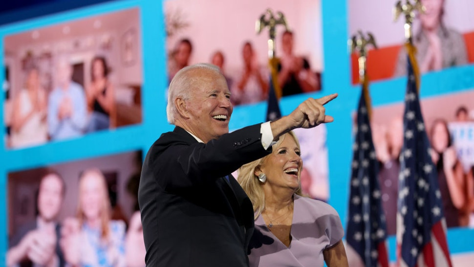 WILMINGTON, DELAWARE - AUGUST 20: : Democratic presidential nominee Joe Biden and his wife Dr. Jill Biden wave to supporters via video teleconference after Biden delivered his acceptance speech on the fourth night of the Democratic National Convention from the Chase Center on August 20, 2020 in Wilmington, Delaware. The convention, which was once expected to draw 50,000 people to Milwaukee, Wisconsin, is now taking place virtually due to the coronavirus pandemic. (Photo by Win McNamee/Getty Images)