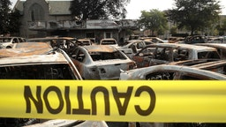 KENOSHA, WISCONSIN - AUGUST 24: Vehicles sit burned out at a used car lot after a night of unrest, on August 24, 2020 in Kenosha, Wisconsin. The unrest stemmedfrom an incident in whichpolice shot a Black man multiple times in the back as he entered the driver's side door of a vehicle. (Photo by Scott Olson/Getty Images)