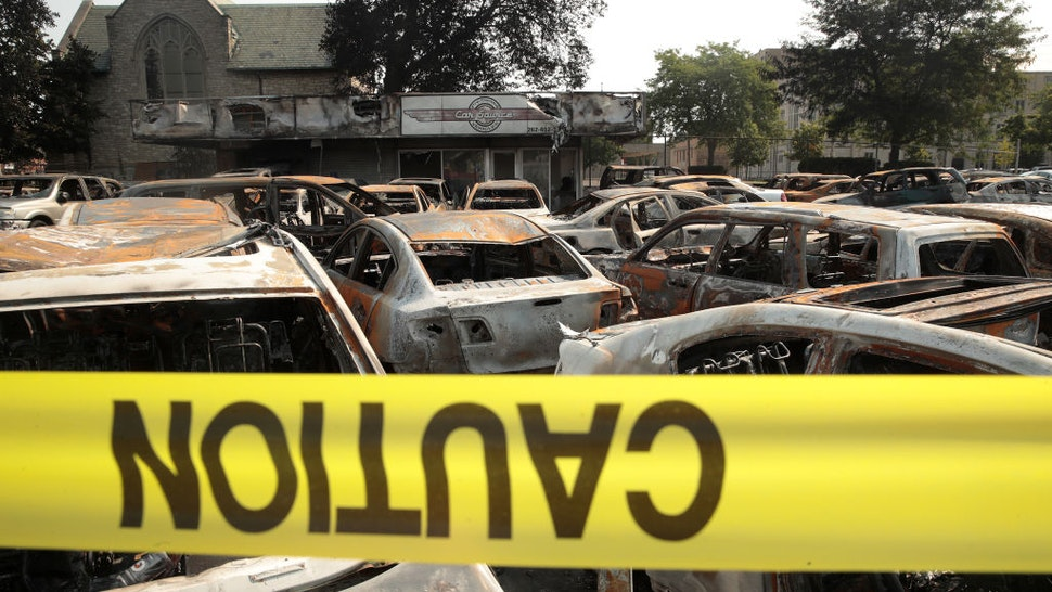 KENOSHA, WISCONSIN - AUGUST 24: Vehicles sit burned out at a used car lot after a night of unrest, on August 24, 2020 in Kenosha, Wisconsin. The unrest stemmed from an incident in which police shot a Black man multiple times in the back as he entered the driver's side door of a vehicle. (Photo by Scott Olson/Getty Images)