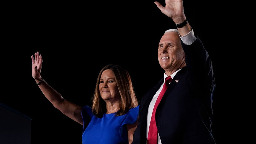Mike Pence stands with his wife Karen Pence before accepting the vice presidential nomination during the Republican National Convention from Fort McHenry National Monument on August 26, 2020 in Baltimore, Maryland.