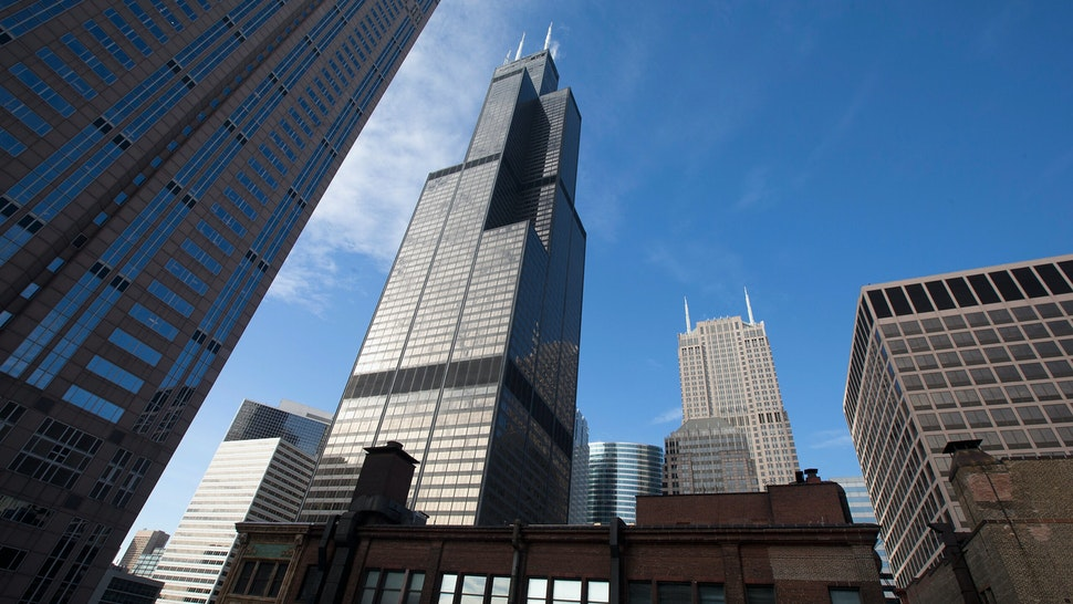 HICAGO, IL - MARCH 04: The Willis Tower (C), formerly known as the Sears Tower, dominates the southern end of the downtown skyline on March 4, 2015 in Chicago, Illinois. The building, completed in 1973, was the world's tallest for more than two decades. It is reported to be up for sale with an asking price of $1.5 billion. (Photo by Scott Olson/Getty Images)
