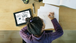 Child working on an Invention - stock photo