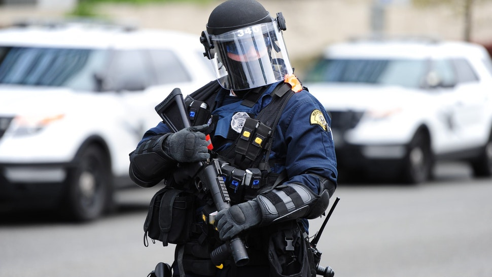 SEATTLE, USA - MAY 1: Police in riot gear block the entrance to the freeway as protesters march through the streets on International Workers' Day in Seattle, Wash., United States on May 1, 2017. (Photo by Alex Milan Tracy/Anadolu Agency/Getty Images)