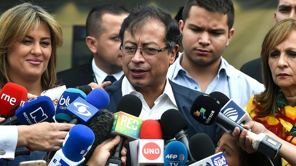 Presidential candidate Gustavo Petro talks to journlists after casting his vote at a polling station during the second round of the presidential elections in Bogota, Colombia on June 17, 2018 - Polls opened Sunday in Colombia for the presidential run-off election pitting conservative front-runner Ivan Duque against leftist former Bogota mayor and ex-guerrilla Gustavo Petro, the first since a peace deal with FARC rebels was signed.