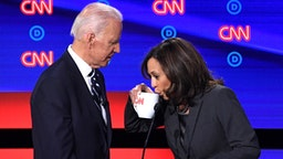 Democratic presidential hopefuls Former Vice President Joe Biden (L) and US Senator from California Kamala Harris chat during a break in the second round of the second Democratic primary debate of the 2020 presidential campaign season hosted by CNN at the Fox Theatre in Detroit, Michigan on July 31, 2019.