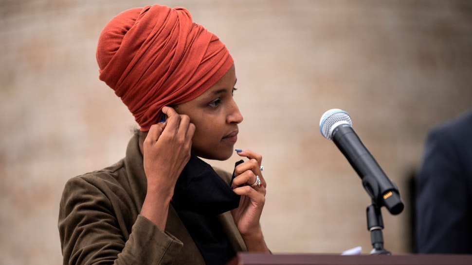 ST PAUL, MN - AUGUST 05: Rep. Ilhan Omar (D-MN) removes her mask to speak during a press conference outside the DFL Headquarters on August 5, 2020 in St Paul, Minnesota. Omar is hoping to retain her seat as the representative for Minnesota's 5th Congressional District in next week's primary election. (Photo by Stephen Maturen/Getty Images)