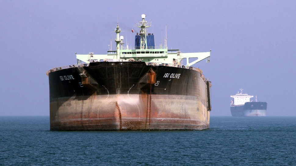 An oil tanker is seen off the port of Bandar Abbas, southern Iran, on July 2, 2012. Iran has come up with several methods to foil the European insurance embargo on ships loaded with its crude, a sanction which may harm its vital exports as much as the EU oil embargo itself.