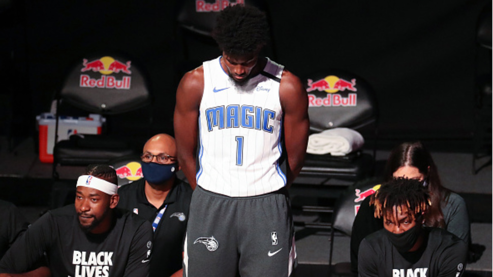 """Orlando Magic forward Jonathan Isaac (1) is the lone player to stand and not wear a """"Black Lives Matter"""" t-shirt prior to a game against the Brooklyn Nets at Disney's Wide World of Sports' HP Field House in Lake Buena Vista, Florida, on Friday, July 31, 2020."""