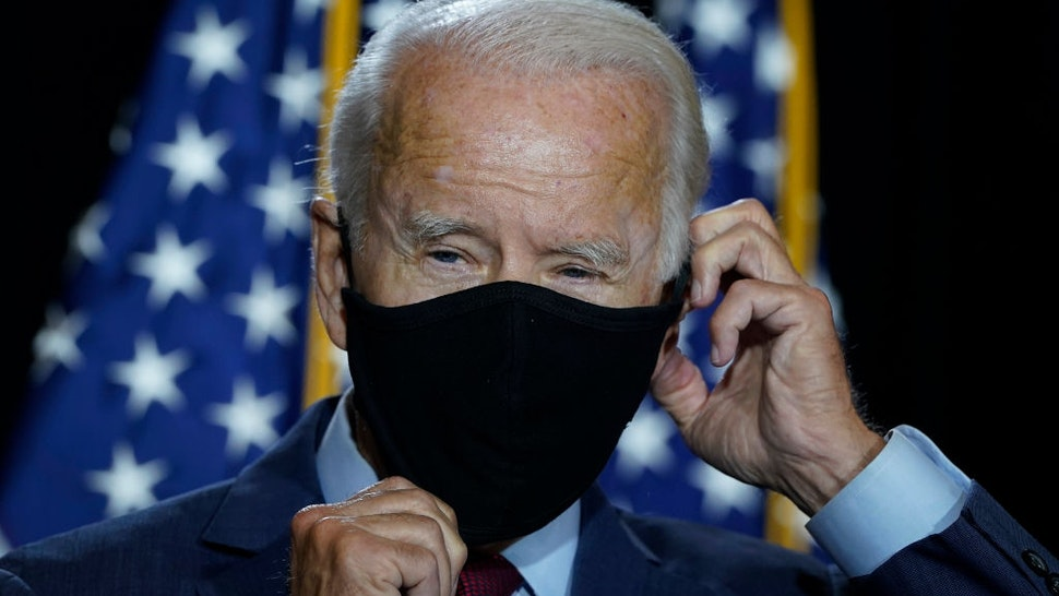 WILMINGTON, DE - AUGUST 13: Presumptive Democratic presidential nominee former Vice President Joe Biden puts his mask back on after delivering remarks following a coronavirus briefing with health experts at the Hotel DuPont on August 13, 2020 in Wilmington, Delaware. Harris is the first Black woman and first person of Indian descent to be a presumptive nominee on a presidential ticket by a major party in U.S. history. (Photo by Drew Angerer/Getty Images)