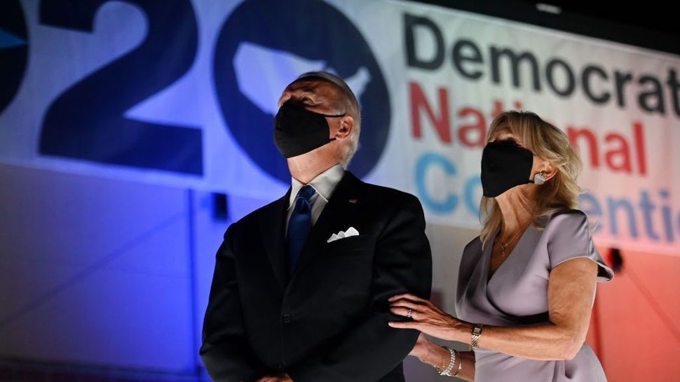 Jill Biden and husband former vice-president and Democratic presidential nominee Joe Biden wear facemasks as they watch fireworks outside the Chase Center in Wilmington, Delaware, at the conclusion of the Democratic National Convention, held virtually amid the novel coronavirus pandemic, on August 20, 2020. (Photo by Olivier DOULIERY / AFP) (Photo by OLIVIER DOULIERY/AFP via Getty Images)