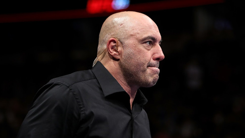 CHICAGO, IL - JUNE 09: Joe Rogan enters the octagon during the UFC 225: Whittaker v Romero 2 event at the United Center on June 9, 2018 in Chicago, Illinois.