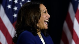 Democratic vice presidential running mate, US Senator Kamala Harris, laughs as she listens to presidential nominee and former US Vice President Joe Biden speak during their first press conference together in Wilmington, Delaware, on August 12, 2020.