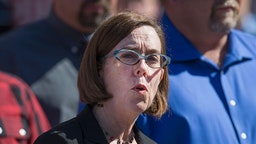 ROSEBURG, OR - OCTOBER 02: Oregon governor Kate Brown speaks to the press about the mass shooting at Umpqua Community College on October 2, 2015 in Roseburg, Oregon. Yesterday 26-year-old Chris Harper Mercer went on a shooting rampage at the campus, killing 9 people and wounding another seven before he was killed. (Photo by Scott Olson/Getty Images)