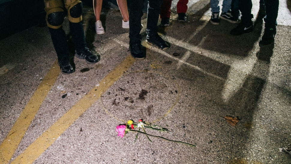 KENOSHA, WI - AUGUST 26: Demonstrators revisit the site where a man was murdered on August 26, 2020 in Kenosha, Wisconsin. On August 25, 17-year-old Kyle Rittenhouse shot and killed two demonstrators. As the city declared a state of emergency curfew, a fourth night of civil unrest occurred after the shooting of Jacob Blake, 29, on August 23. Video shot of the incident appears to show Blake shot multiple times in the back by Wisconsin police officers while attempting to enter the drivers side of a vehicle. The 29-year-old Blake was undergoing surgery for a severed spinal cord, shattered vertebrae and severe damage to organs, according to the family attorneys in published accounts. (Photo by Brandon Bell/Getty Images)
