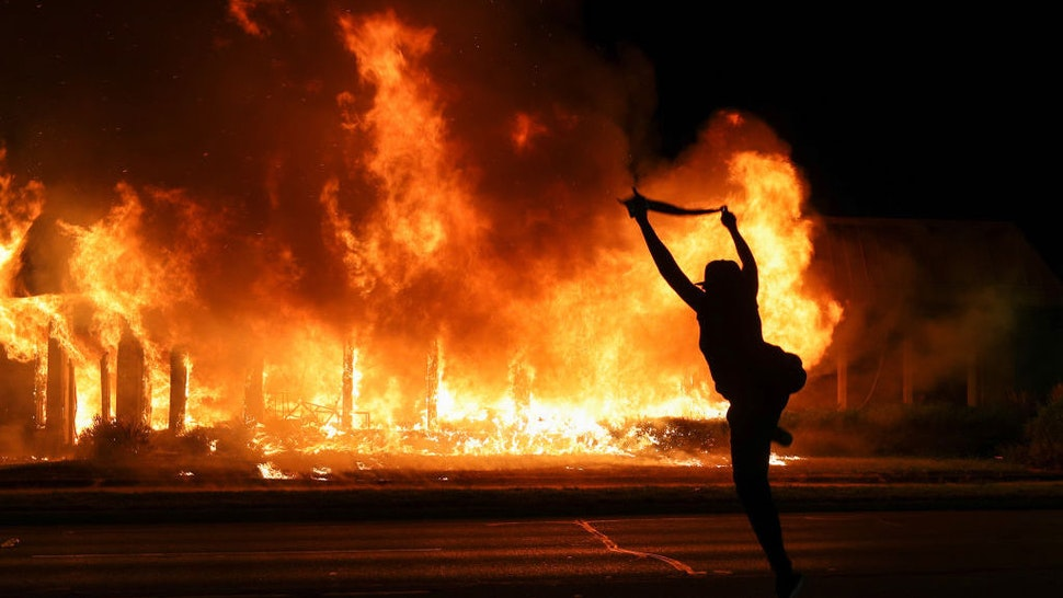 Jacob Blake protesters lit buildings on fire in Kenosha, Wisconsin, United States on August 24, 2020. A police shooting in the US state of Wisconsin sent a Black man into serious condition on Sunday, with the video footage of the incident triggering outrage. (Photo by Tayfun Coskun/Anadolu Agency via Getty Images)