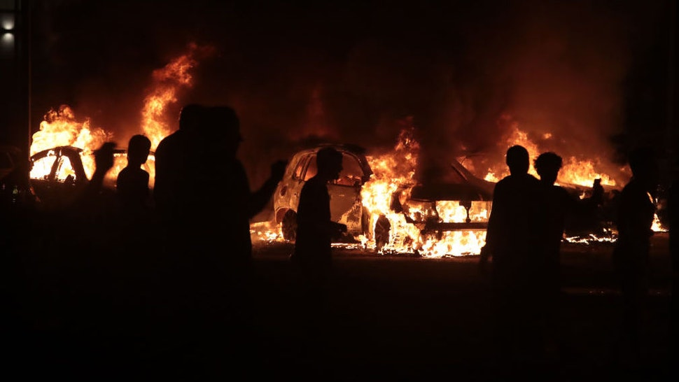 Fires burn around downtown during a second night of rioting on August 24, 2020 in Kenosha, Wisconsin. Rioting as well as clashes between police and protesters began Sunday night after a police officer shot Jacob Blake 7 times in the back in front of his three children. (Photo by Scott Olson/Getty Images)