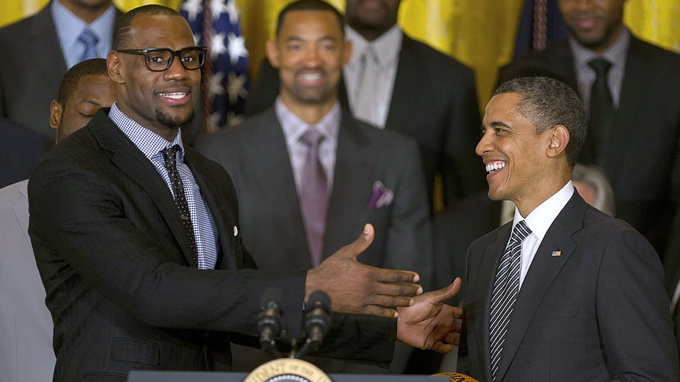 US President Barack Obama (R) poses with LeBron James as he welcomes the NBA Champion Miami Heat to the White House to honor the team and their 2012 NBA Championship victory at the White House in Washington, DC, January 28, 2013. (Jim Watson/AFP via Getty Images)