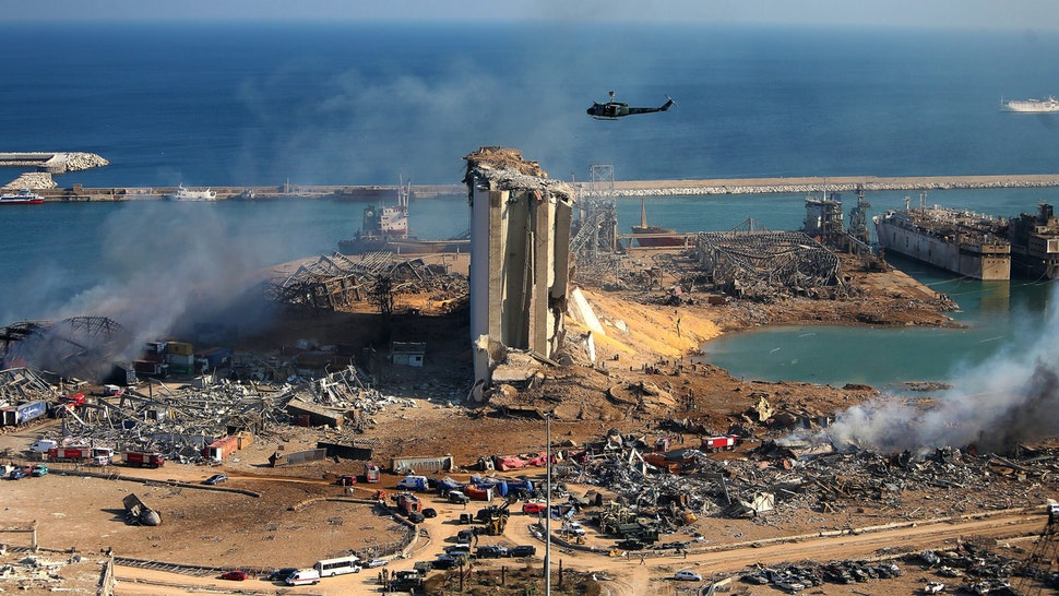 A general view shows the damaged grain silos of Beirut's harbour and its surroundings on August 5, 2020, one day after a powerful twin explosion tore through Lebanon's capital, resulting from the ignition of a huge depot of ammonium nitrate at the city's main port. - Rescuers searched for survivors in Beirut after a cataclysmic explosion at the port sowed devastation across entire neighbourhoods, killing more than 100 people, wounding thousands and plunging Lebanon deeper into crisis. The blast, which appeared to have been caused by a fire igniting 2,750 tonnes of ammonium nitrate left unsecured in a warehouse, was felt as far away as Cyprus, some 150 miles (240 kilometres) to the northwest.