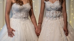 TAIPEI, TAIWAN - MAY 18: Lesbian couple Amber and Huan Huan hold hands during a wedding event to raise HIV awareness a day after Taiwan's parliament voted to legalise same-sex marriage, on May 18, 2019 in Taipei, Taiwan. Taiwan yesterday became the first country in Asia to legalise same-sex marriage after lawmakers voted to allow same-sex couples full legal marriage rights, including areas in taxes, insurance and child custody. Thousands of gay rights supporters gathered outside the parliament building in the nation's capital as the result was announced. The bill will go into effect on May 24.