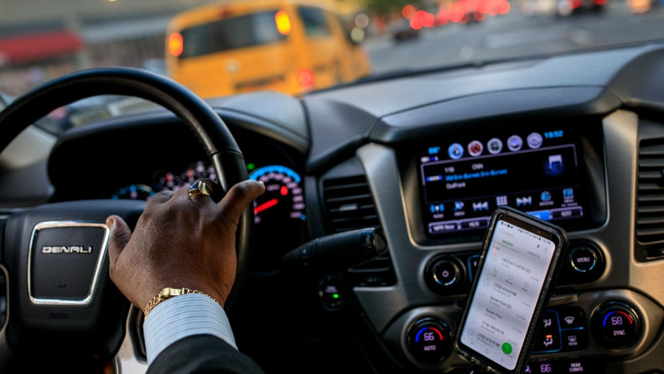 NEW YORK, NY - AUGUST 8: After dropping off passengers at a Broadway play, Johan Nijman, a for-hire driver who runs his own service and also drives for Uber on the side, drives through the West Side of Manhattan on Wednesday evening, August 8, 2018 in New York City. On Wednesday, New York City became the first American city to halt new vehicles for ride-hail services. The legislation passed by the New York City Council will cap the number of for-hire vehicles for one year while the city studies the industry. The move marks a setback for Uber in its largest U.S. market. Nijman, a member of the Independent Drivers Guild who has been driving in various capacities since 1991, says the temporary vehicle cap is a good start but he would like to see the city do more to deal with the over-saturation of vehicles and new drivers.