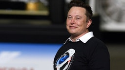 CAPE CANAVERAL, UNITED STATES - 2020/05/30: SpaceX founder Elon Musk looks on after being recognized by U.S. President Donald Trump at NASA's Vehicle Assembly Building after watching the successful launch of a Falcon 9 rocket with the Crew Dragon spacecraft from pad 39A at the Kennedy Space Center. NASA astronauts Doug Hurley and Bob Behnken will rendezvous and dock with the International Space Station, becoming the first people to launch into space from American soil since the end of the Space Shuttle program in 2011.