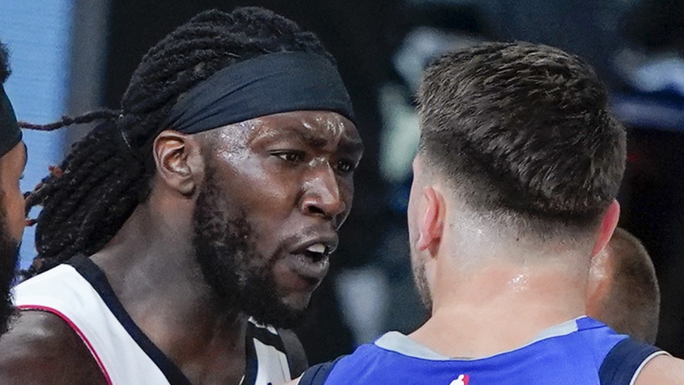 LAKE BUENA VISTA, FLORIDA - AUGUST 21: Amir Coffey #7 of the LA Clippers and Luka Doncic #77 of the Dallas Mavericks exchange words during the first half of Game Three of first round playoffs at the AdventHealth Arena at the ESPN Wide World Of Sports Complex on August 21, 2020 in Lake Buena Vista, Florida.