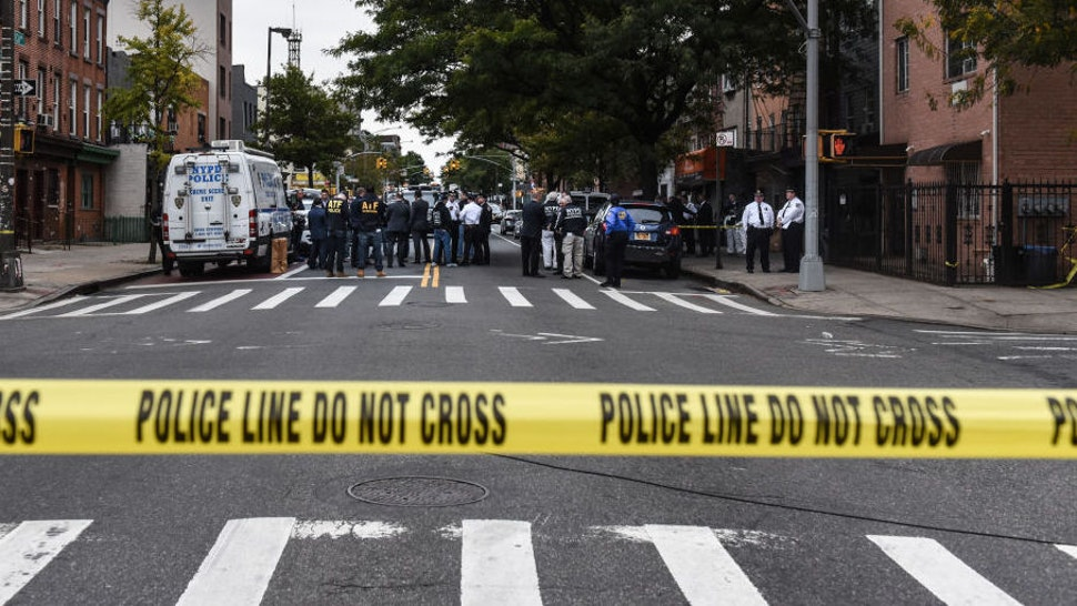 A crime scene is established in front of the Triple A Aces social club on Utica Avenue on October 12, 2019 in New York City. At least four people were declared dead and three others wounded in an early morning gun fight at an illegal gambling location, according to the NYPD. (Photo by Stephanie Keith/Getty Images)