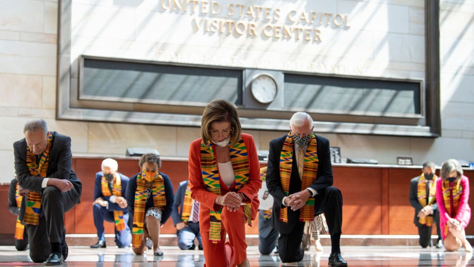 UNITED STATES - JUNE 8: Speaker of the House Nancy Pelosi, D-Calif., and other members of Congress gather at the Emancipation Hall, kneel as they take moment of silence to honor George Floyd, and victims of racial injustice on Monday, June 8, 2020. (Photo by Caroline Brehman/CQ Roll Call)