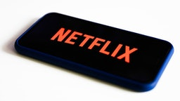 Netflix logo is seen displayed on phone screen in this illustration photo taken in Poland on July 17, 2020. On-Demand streaming services gained popularity and new subscribers during the coronavirus pandemic.