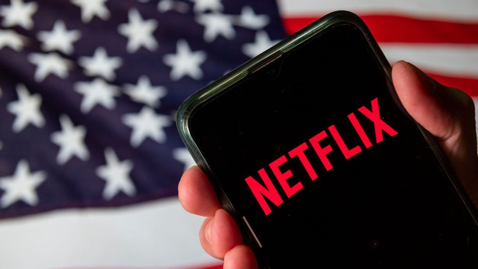In this photo illustration the American global on-demand Internet streaming media provider Netflix logo is seen on an Android mobile device with United States of America flag in the background. (Photo Illustration by Budrul Chukrut/SOPA Images/LightRocket via Getty Images)