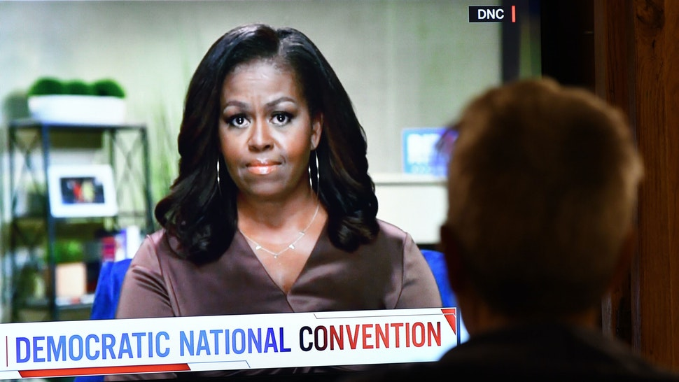 A person watches former First Lady Michelle Obama speak during the opening night of the Democratic National Convention, being held virtually amid the novel coronavirus pandemic, in Los Angeles, on August 17, 2020. - America's political convention season begins tonight with former first lady Michelle Obama addressing the Democrats' now-virtual gathering set to anoint Joe Biden, as President Donald Trump defies coronavirus concerns to rally supporters in battleground Wisconsin.
