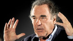 """BOLOGNA, ITALY - JULY 07: Director Oliver Stone introduces """"The Doors"""" during the Cinema Ritrovato Festival at Piazza Maggiore on July 07, 2019 in Bologna, Italy."""