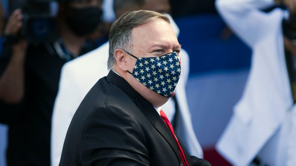 US Secretary of State Mike Pompeo walks upon arrival at the National Congress to attend the inauguration ceremony of Dominican new President Luis Abinader, in Santo Domingo, on August 16, 2020. - Luis Abinader, of the Modern Revolutionary Party,is a politician, economist and businessman who will be sworn for a four-year term as the sixty-seventh president of the Dominican Republic.